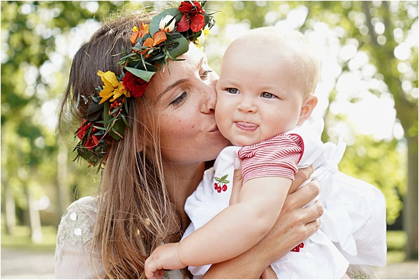 Bride kissing the cutest baby