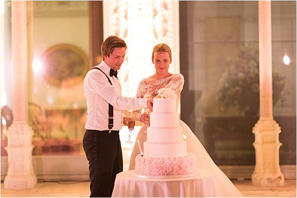 Cutting the cake at their Villa Ephrussi de Rothschild wedding