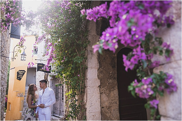 Engaged couple stroll through french riviera town