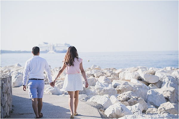 Engaged couple walks by the french riviera