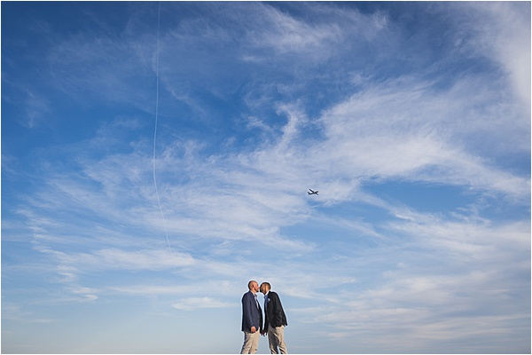 Gay couple engaged at the french riviera with amazing skies