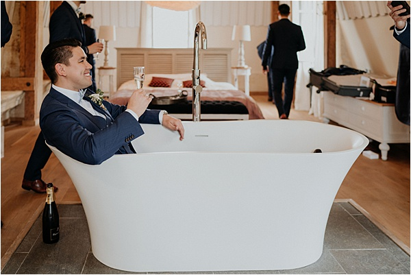 Groom hanging out in the bathtub