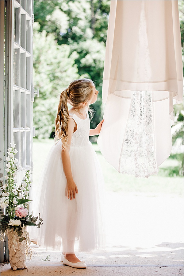 Little Bridesmaid admiring Belle et Dentelle Dress