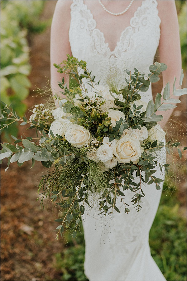 White wedding dress and bouquet