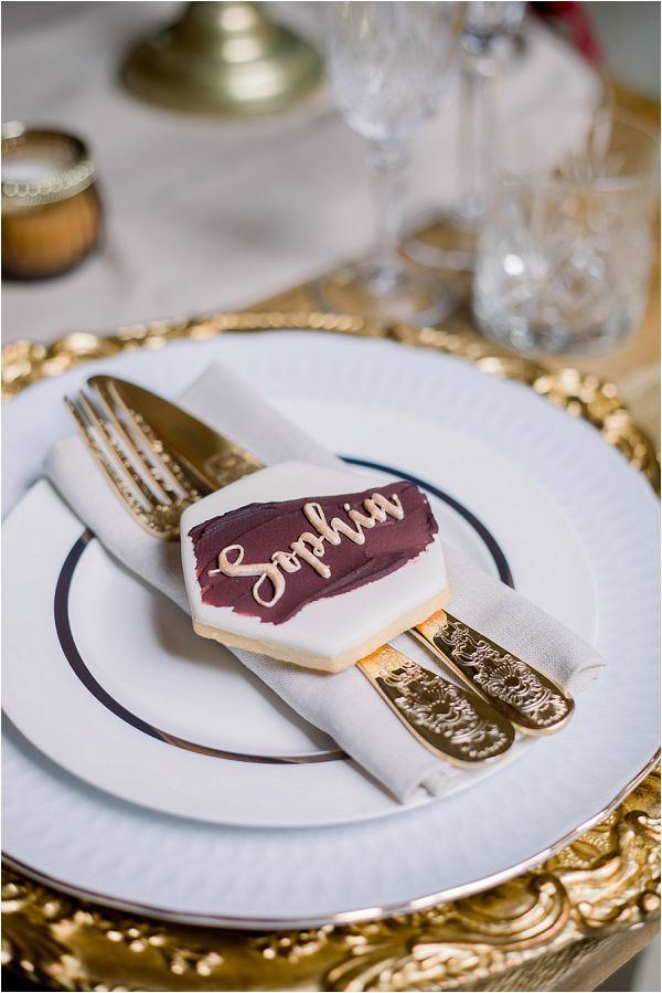 burgundy wedding table setting Image by Daria Lorman Photography