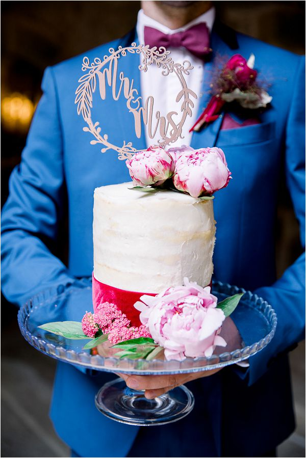 cream and red wedding cake Image by Daria Lorman Photography