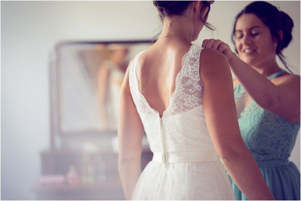 lace back wedding dress | Photography by Wedding Fusion Imagery