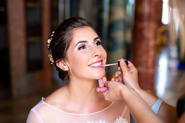 Bride has makeup done