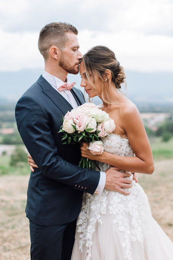 bride and groom kiss after getting married
