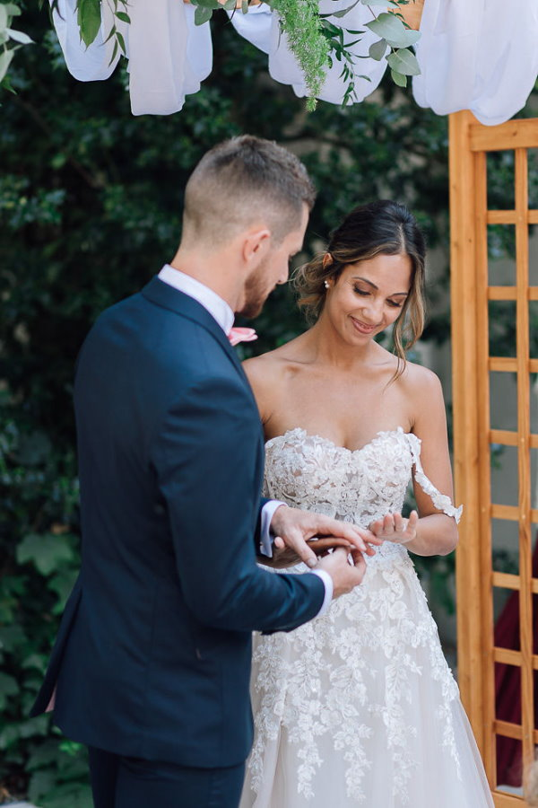 exchanging rings at chartreuse de pomier