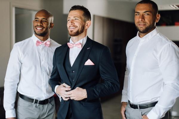 groom puts on suit