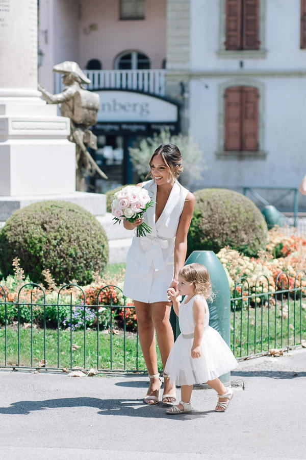 bride and flower girl arrive at wedding
