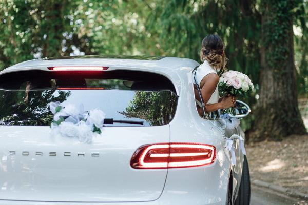 bride arrives in white porsche wedding car