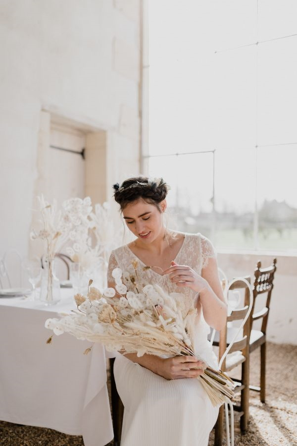 Bride Seated with White Floral Bouquet