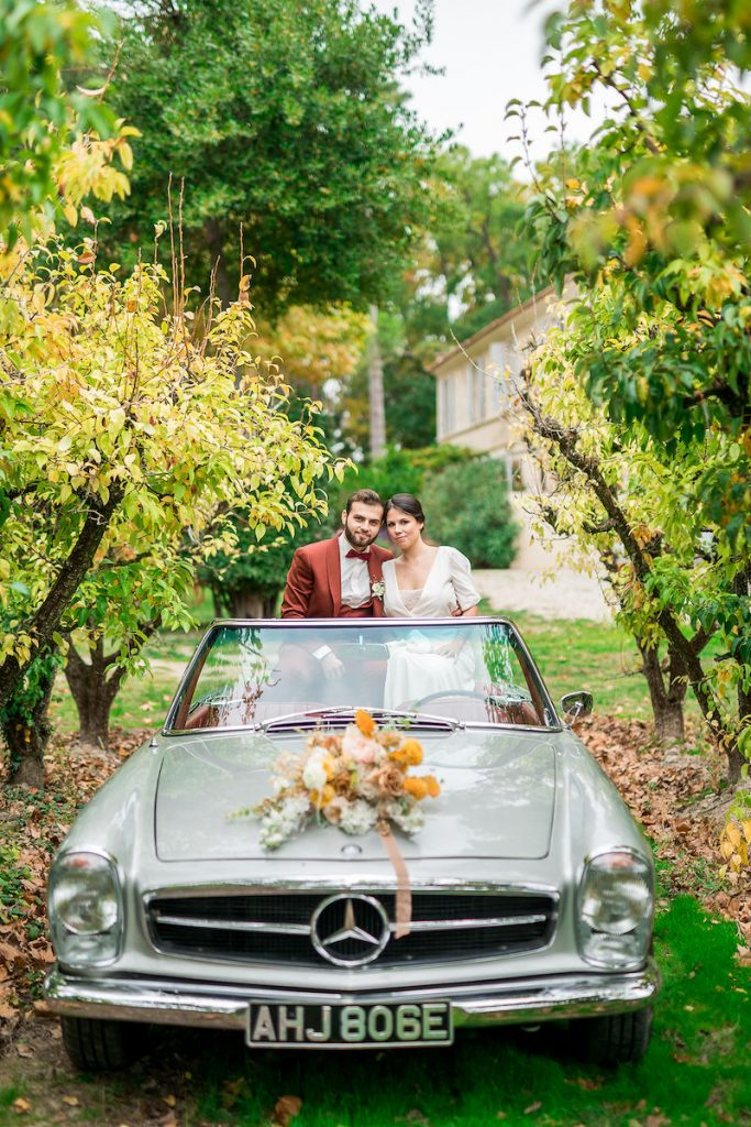 Just married couple in wedding car