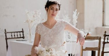 1920s themed wedding in Grand Siecle Chateau Feature Image of Bride