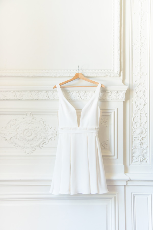 Brides Dress on Hanger against Detailed chateau wall