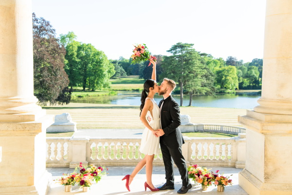 Couple kiss after exchanging vows at Chateau Rothschild