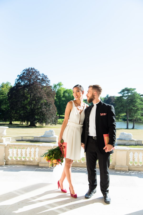 Couple hold hands after Intimate Exchange of Vows at Chateau Rothschild