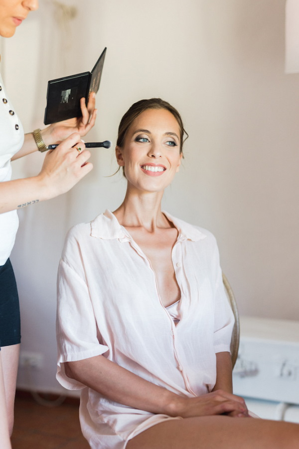 Bride gets makeup done in pink pastel pyjamas