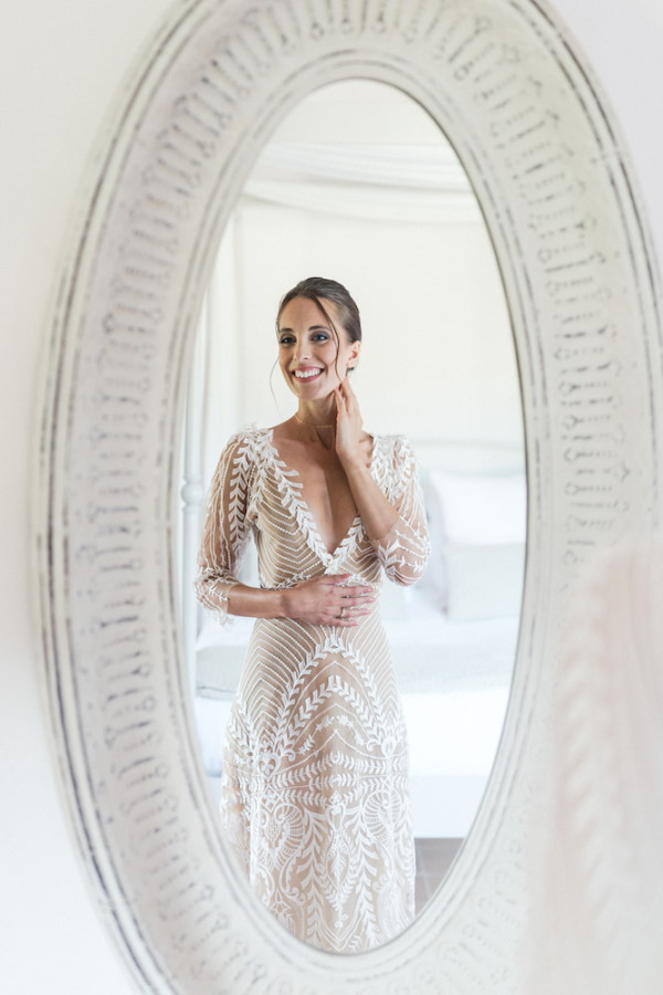 Bride is ready and captured in an oval mirror
