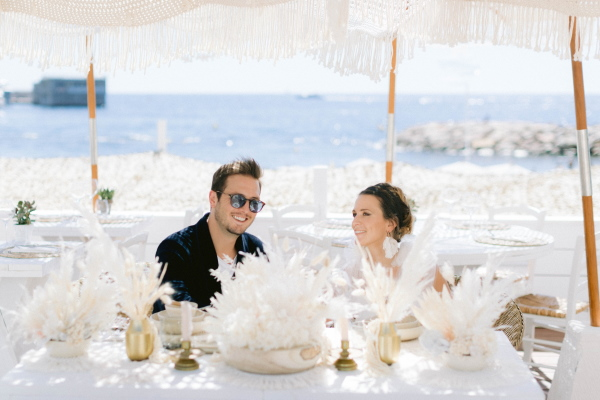 Greek Wedding in Naos Beach France Bride and Groom at Wedding Table