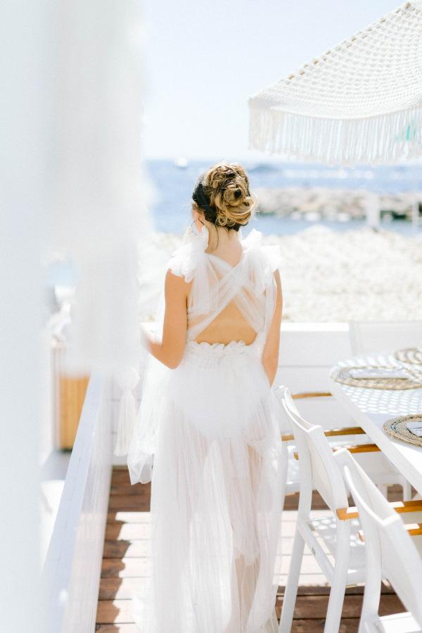 Back of Sheer White Wedding Dress at Naos Beach, France