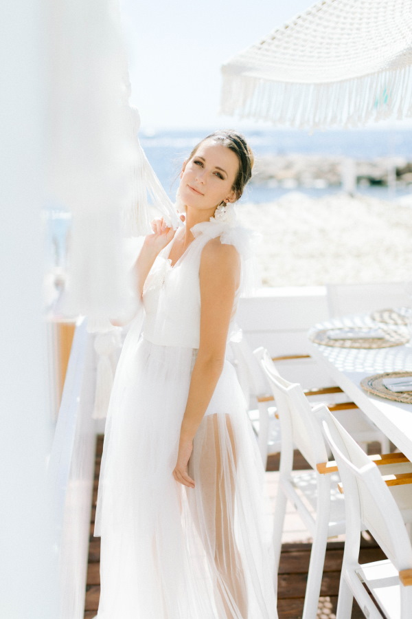 Bride in Sheer White Dress at Naos Beach in France
