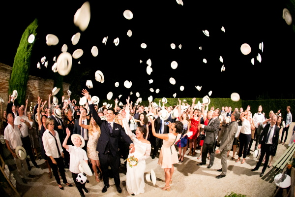 Eléna Fleutiaux Photo of Wedding Guests Throwing Hats