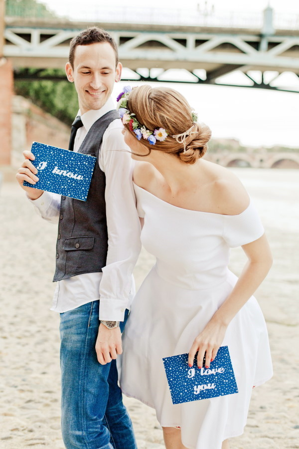Eléna Fleutiaux Photo of Bride and Groom Holding I love you signs