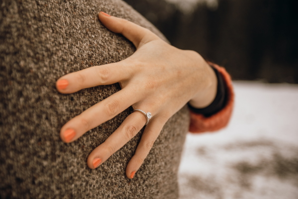 Woman's hand with engagement ring from Taylor & Hart