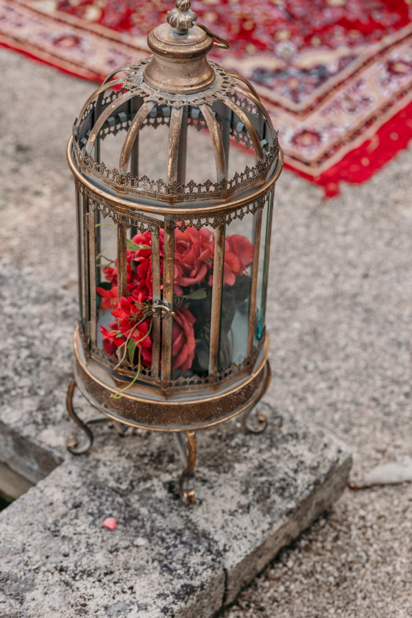 Red flowers fill antique brass dome