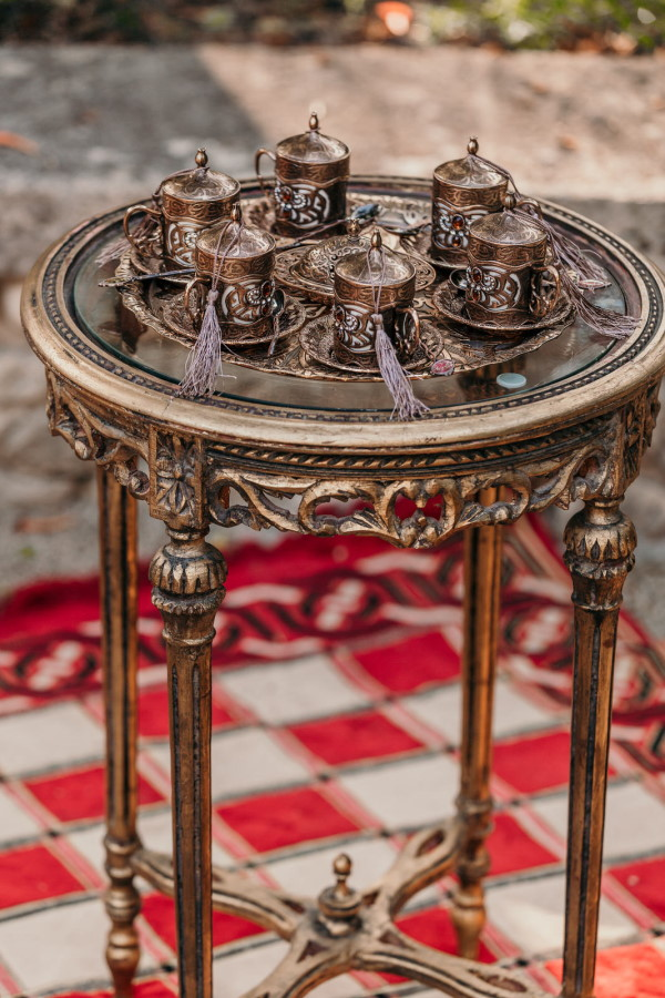 Asian themed tea set on antique brass coffee table