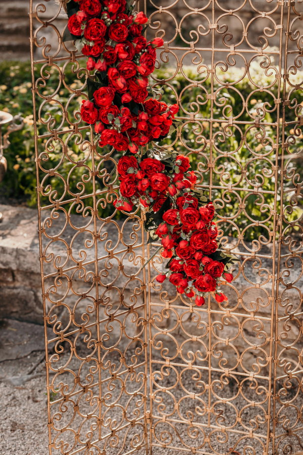 Red flowers cascade down outdoor folding screen