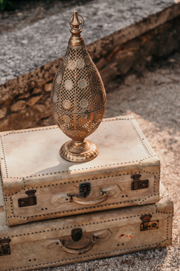 Oriental lamp on antique luggage wedding decor