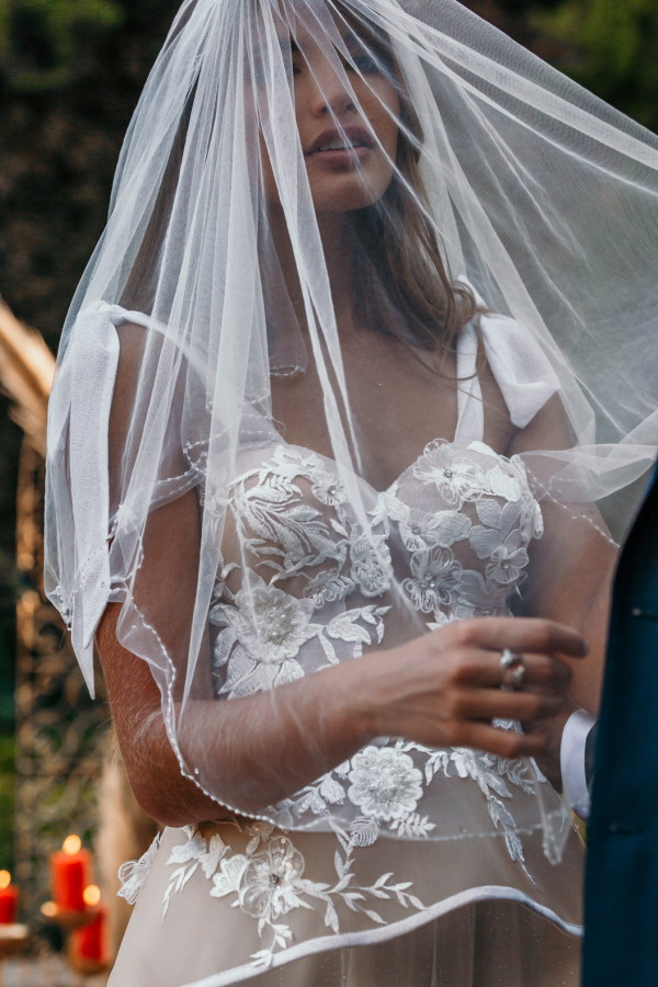 French bride in veil and lace white dress