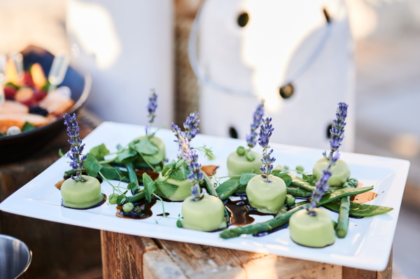 Pastel green hors d'oeuvres with lavender flowers
