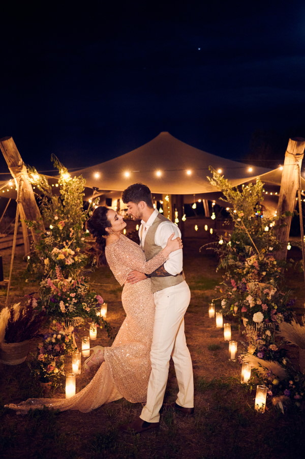 Wedding Tents in the Lavender Meadows of Domaine de Bres couple kiss under festoon lights