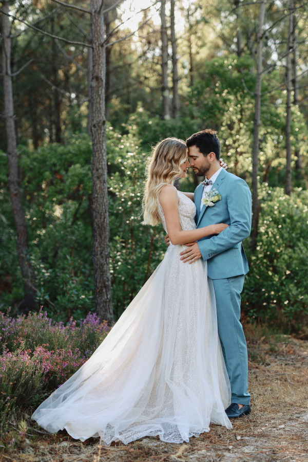 Bride and groom embrace where forest meets ocean at wedding in Le Petit Nice France