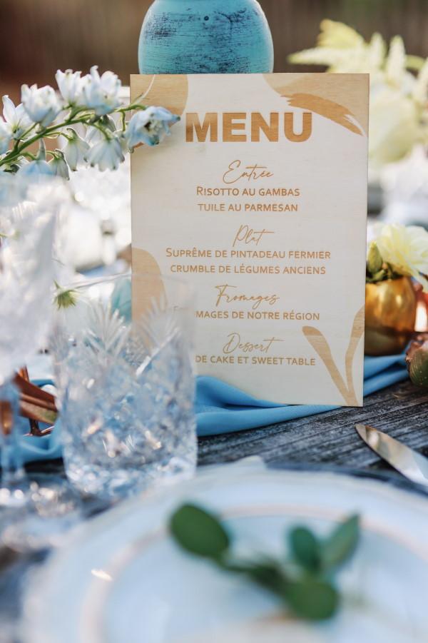 Wooden wedding menu card close up