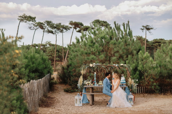 Couple at wedding table by the sea at Le Petit Nice with ocean wedding theme