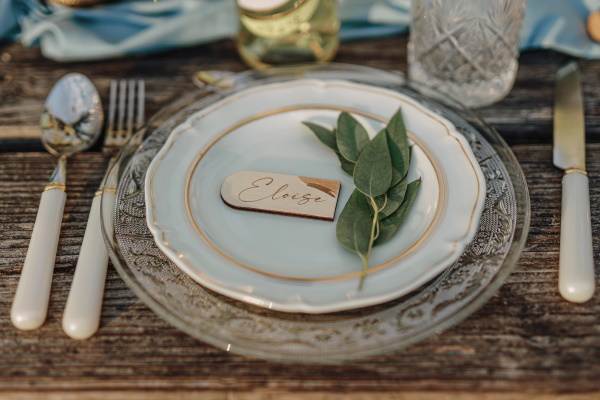 Leaf and wooden name place natural wedding table setting
