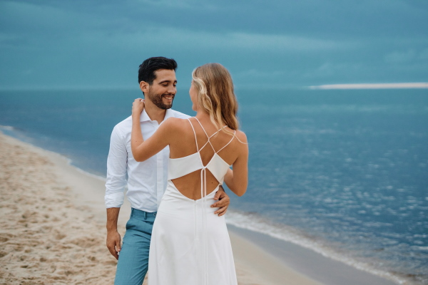 Bride in open back silk dress by the blue ocean of Le Petit Nice, France