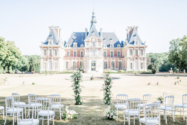 Wedding ceremony set up in the gardens of Chateau de Baronville, France