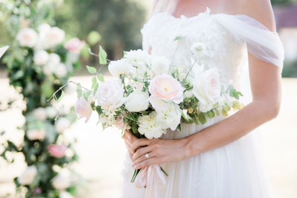 Closeup of brides pastel pink and white rose bouquet