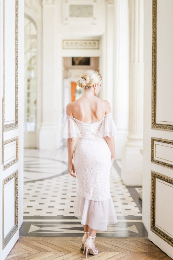 Bride walks away from camera in three quarter length gown and golden heels