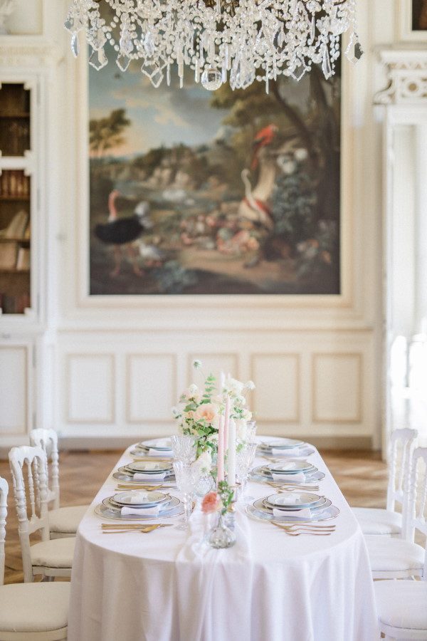 Wedding table at literary themed wedding between two book lovers inside Chateau de Baronville, France