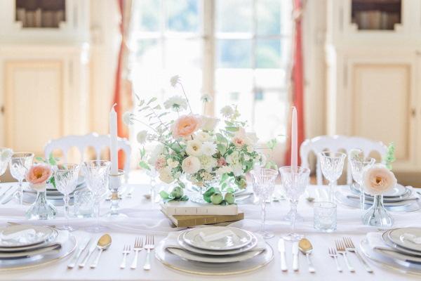 bridal table set up in pastels inside Chateau de Baronville France