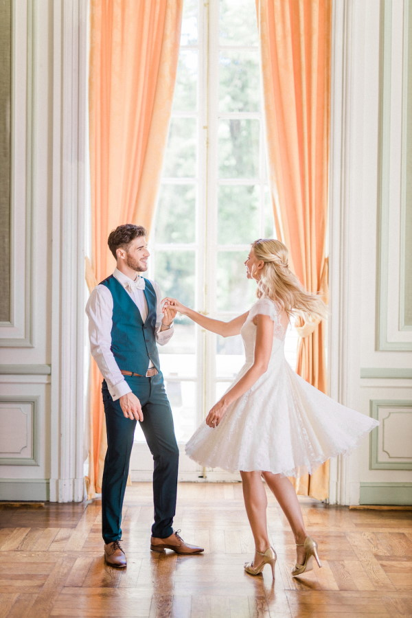 Bride and groom dance on parquet floors in Chateau de Baronville, France