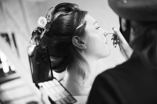 bride has makeup done before wedding
